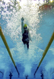 Australia's Jodie Henry broke a Commonwealth record in the heats of the Women's 100m Freestyle.