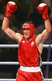Australia's Brad Pitt celebrates his win over Heavyweight favourite England.