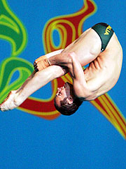 Mathew Helm, between platform and pool in his10m dive.