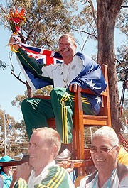 Australian Bruce Scott is carried from the dias in the Queens Chair, after the singles Open FuShooting competition.ll Bore