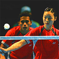 Yujia Li of Singapore is a picture of concentration as her partner Hendri Saputra watches.