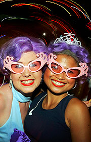 Two of one thousand Dame Edna's - Melbourne's housewife superstar.