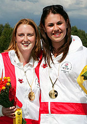 Rachel Parish (l) and Charlotte Kerwood (r) of England share the joy of winning gold and silver in the Women's Double Trap Pairs.