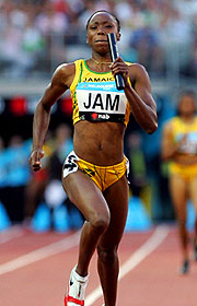 Sherone Simpson of Jamaica wins the Women's 4x100m Relay.