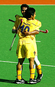 Malaysia's Ahmed Tengku celebrates a bronze medal victory over England with a team-mate in Men's Hockey.