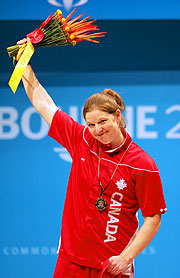 Jeane Lassen of Canada wings gold and the Games record in the Women's 69kg Weightlifting.