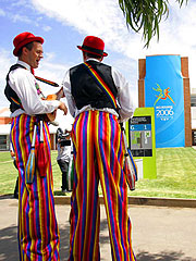 Performers entertain Athletes' Village visitors on tour.